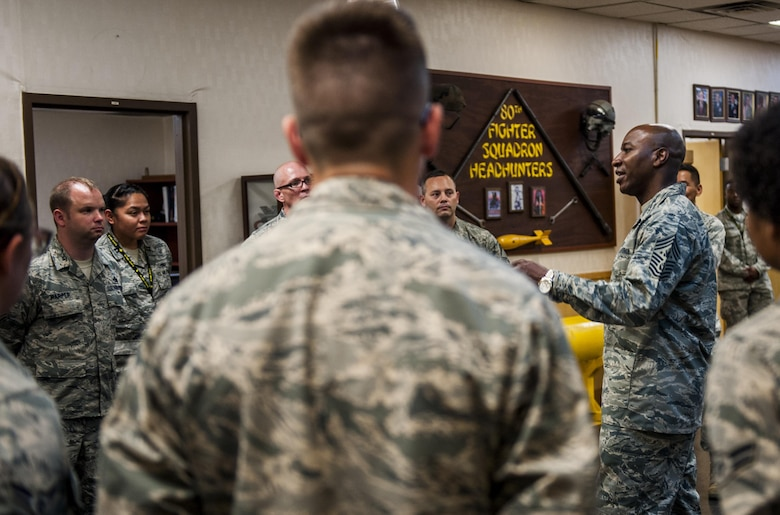Chief Master Sgt. of the Air Force Kaleth O. Wright speaks to members of the 80th Fighter Squadron as he takes a tour of the squadrons at Kunsan Air Base, Republic of Korea, June 6, 2017. Wright is the 18th Chief Master Sergeant of the Air Force. Wright is taking a tour of many bases in the Pacific theater to meet with airmen and discuss his focus areas as CMSAF as well as the Air Force mission. (U.S. Air Force photo by Senior Airman Colville McFee/Released)