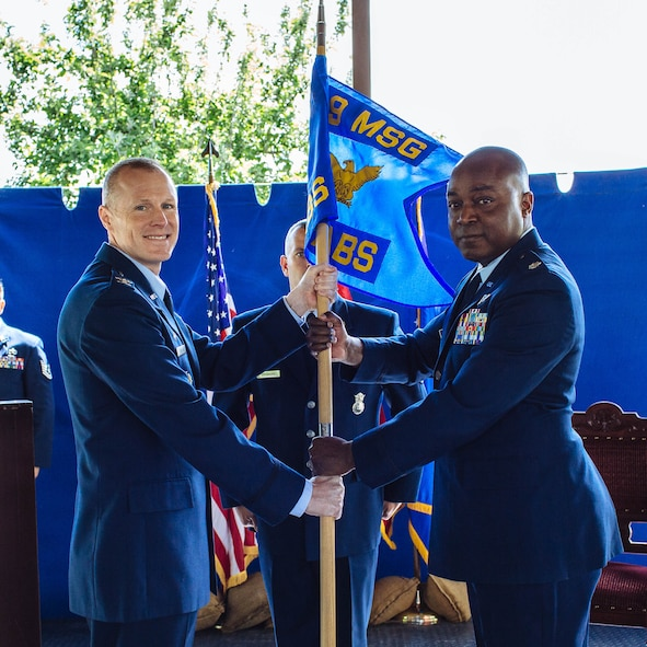 Col. Todd Stratton, 39th Air Base Wing Mission Support Group commander (left), presents the guidon to Lt. Col. Christopher Floyd , 717th Air Base Squadron commander (right), during the 717th ABS change of command ceremony May 16, 2017, at the Ankara Support Facility, Turkey. A change of command ceremony is a tradition that represents a formal transfer of authority and responsibility from the outgoing commander to the incoming commander. (U.S. Air Force courtesy photo)