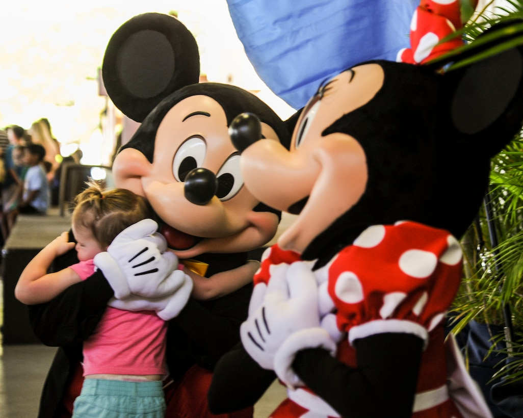 Mickey and Minnie Mouse take photos with fans during the Books on Bases event at the Hickam Officers Club, hosted by Blue Star Families, Joint Base Pearl Harbor-Hickam, Hawaii, June 2, 2017.  Blue Star Families program donates books to military children, base libraries, Department of Defense schools, and military-impacted public schools and libraries across the world. (U.S. Air Force photo by Tech. Sgt. Heather Redman)