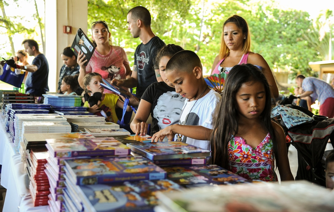 Children pick out books during the Books on Bases event at the Hickam Officers Club, hosted by Blue Star Families, Joint Base Pearl Harbor-Hickam, Hawaii, June 2, 2017.  Blue Star Families program donates books to military children, base libraries, Department of Defense schools, and military-impacted public schools and libraries across the world. (U.S. Air Force photo by Tech. Sgt. Heather Redman)