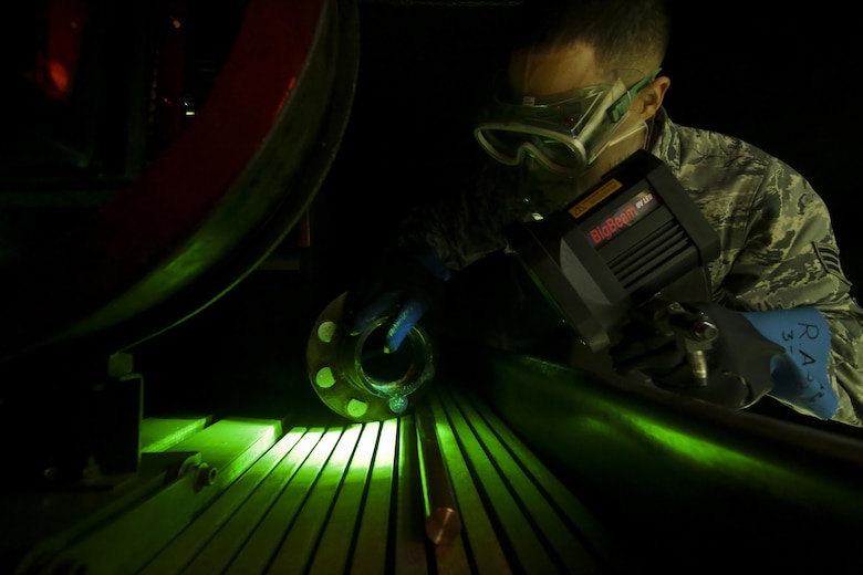 U.S. Air Force Senior Airman Ronald Anazco from the 108th Maintenance Squadron nondestructive inspection (NDI) shop looks at cracks seen on a KC-135 Stratotanker part during a training session at Joint Base McGuire-Dix-Lakehurst, N.J., April 22, 2017. NDI airmen have a variety of technological techniques at their disposal, from fluorescent penetrant to magnetic particle and eddy current testing. (U.S. Air National Guard photo by Master Sgt. Matt Hecht/Released)