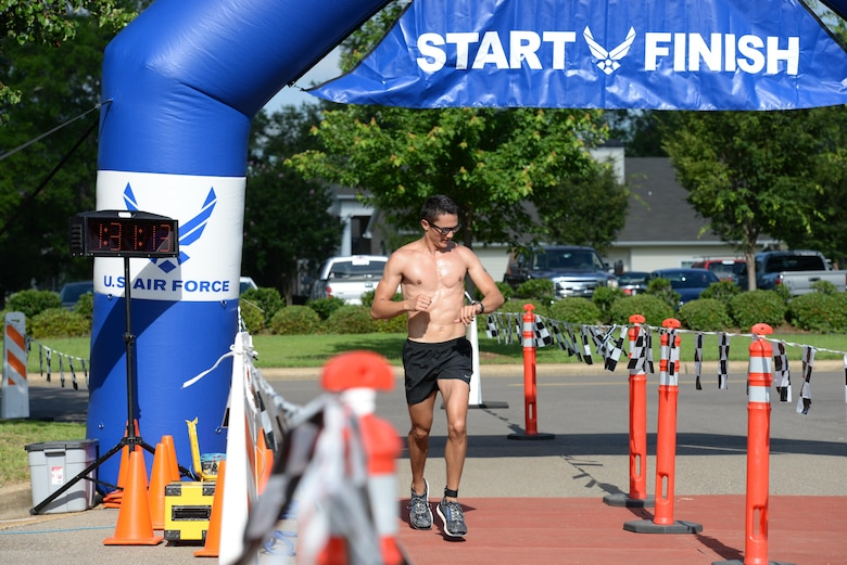 Second Lt. Forrest Schaffer, 14th Student Squadron Student Pilot, finishes the triathlon June 3, 2017, on Columbus AFB, Mississippi. The actual time of the athletes was calculated with ankle bracelets that were synced with electronic pads they passed over at the end and start of each event. (U.S. Air Force photo by Airman 1st Class Keith Holcomb)