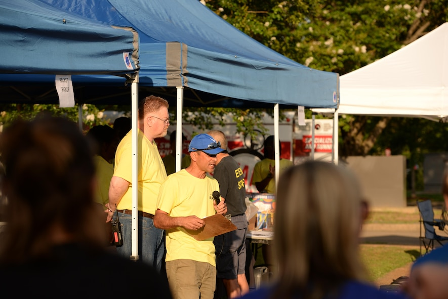 Col. Anthony Sansano, 14th Mission Support Group Commander, speaks to the crowd in the Columbus Club parking lot before a triathlon June 3, 2017, on Columbus Air Force Base, Mississippi. The event staff was in charge of keeping the event safe and had individuals at specific markers to hand water to the participants. (U.S. Air Force photo by Airman 1st Class Keith Holcomb)