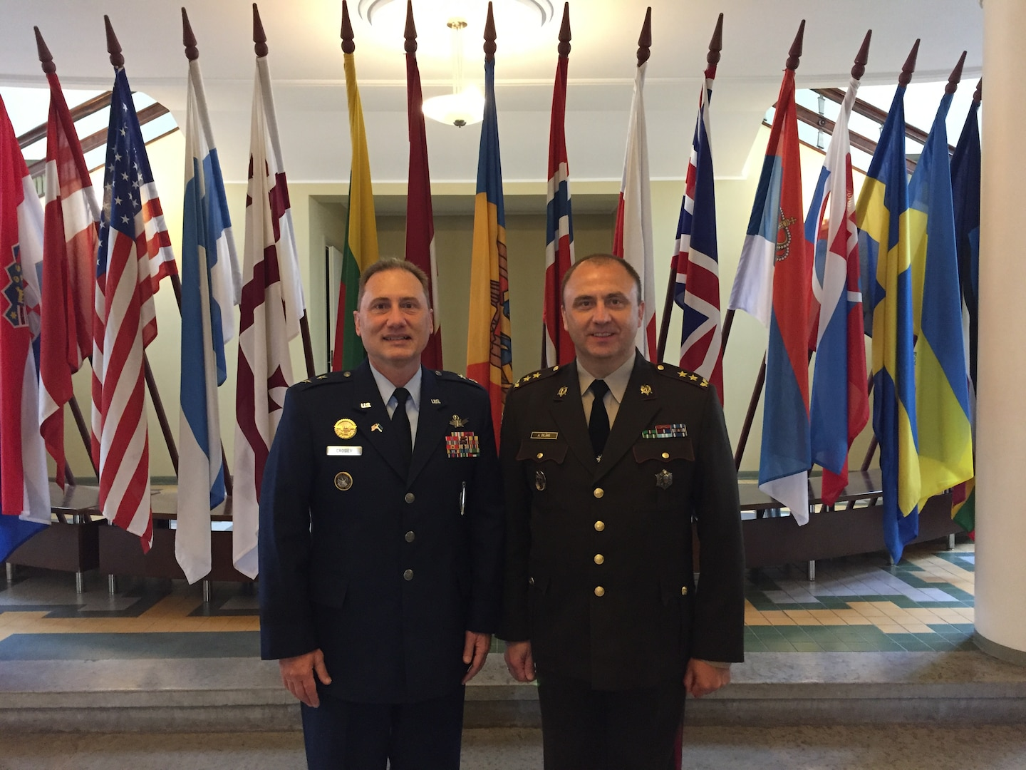 U.S. Air Force Maj. Gen. Clinton E. Crosier (left), U.S. Strategic Command (USSTRATCOM) director of plans and policy, meets with Latvian National Armed Forces Maj. Gen. Andis Dilāns, commandant of the Baltic Defence College, in Tartu, Estonia, May 24, 2017. During the visit, Crosier extended a formal invitation for the Baltic Defence College to join USSTRATCOM's Deterrence and Assurance Academic Alliance, which Dilans accepted. They become the first non-U.S. institution to join. The visit was one leg of a trip to six European countries Crosier made to strengthen ties with NATO allies and academic partners, May 23 to June 2, 2017. One of nine Department of Defense unified combatant commands, USSTRATCOM has global strategic missions assigned through the Unified Command Plan that include strategic deterrence, space operations, cyberspace operations, joint electronic warfare, global strike, missile defense, intelligence, and analysis and targeting.