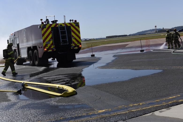 Fairchild fire fighters respond to a simulated airplane crash June 5, 2017, at Fairchild Air Force Base, Washington. Fairchild and local first responders participated in a Major Accident Response Exercise in preparation for Fairchild's upcoming 2017 SkyFest Air Show. (U.S. Air Force Photo/Airman 1st Class Ryan Lackey)