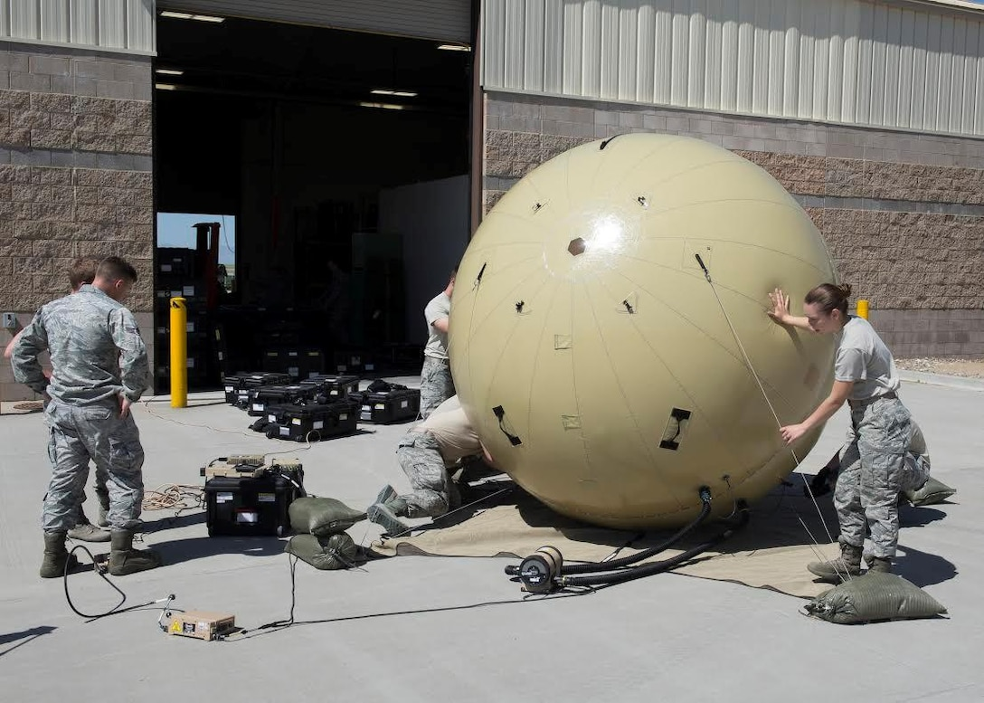 Members of the 726th Air Control Squadron assemble a Small Communications Package May 30, 2017, at Mountain Home Air Force Base, Idaho.  The inflatable system allows smaller teams to transport and employ it without relying on outside agencies. (U.S. Air Force photo by Airman 1st Class Jeremy D. Wolff/Released)