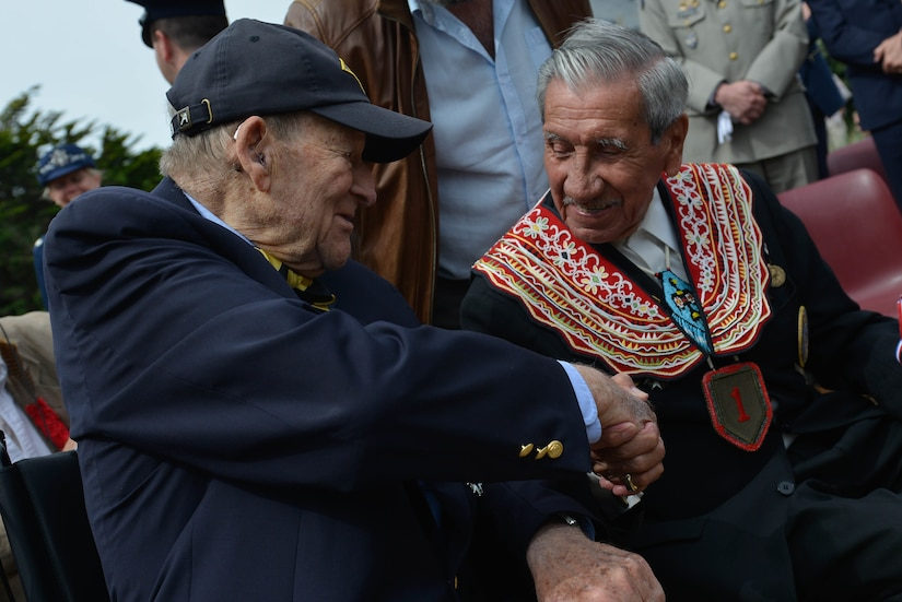 D-Day veterans George Kline and Charles Shay shake hands at the dedications ceremony for the Charles Shay Memorial in Saint-Laurent-sur-Mer, France, June 5, 2017. DoD photo by Air Force Airman 1st Class Alexis C. Schultz
