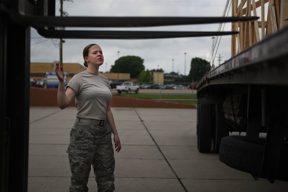 Airman Kylee Boice, 2nd Logistics Readiness Squadron Traffic Management Office receiving technician, guides a forklift as it attempts to pick up a B-52 Stratofortress cowling that had just arrived at Barksdale Air Force Base, La., June 6, 2017. The mission of the 2nd Logistics Readiness Squadron is to provide agile logistics support, anytime, anywhere. (U.S. Air Force photo/Airman 1st Class Stuart Bright)