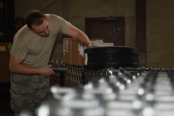 Airman 1st Class Landon Bridges, 2nd Logistics Readiness Squadron Traffic Management Office receiving technician, scans inbound shipments into the Cargo Movement Operations System at Barksdale Air Force Base, La., June 6, 2017. It is receiving technician's job to identify what has been received and where it is supposed to end up. (U.S. Air Force photo/Airman 1st Class Stuart Bright)