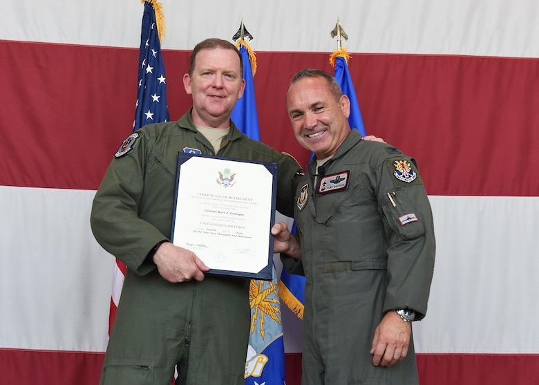 Maj. Gen. Richard Scobee, Air Force Reserve Command vice commander, and Col. Kurt Gallegos, the former 944th Fighter Wing commander, pose with Gallegos' retirement certificate June 3 during the retirement ceremony at Luke Air Force Base, Arizona. (U.S. Air Force photo by Staff Sgt. Lausanne Kinder)