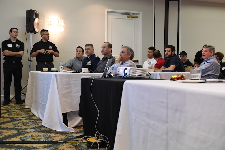 Panelists from the U.S. Department of Defense and commercial space industry listen as California Polytechnic University aerospace engineering students present their satellite design capstone project during a satellite design conference hosted by Cal Poly in Shell Beach, California, June 2, 2017.  The students were responding to a notional solicitation from a fictitious customer that outlined design specifications for a communications and earth-imaging satellite. (U.S. Air Force photo by Capt. Nicholas Mercurio/Released)