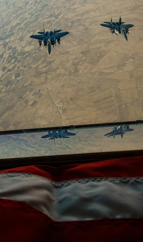 Two U.S. Air Force F-15E Strike Eagles fly in formation after receiving fuel from a 908th Expeditionary Air Refueling Squadron KC-10 Extender during a flight in support of Operation Inherent Resolve June 2, 2017. The F-15E Strike Eagle is a dual-role fighter designed to perform air-to-air and air-to-ground missions. An array of avionics and electronics systems gives the F-15E the capability to fight at low altitude, day or night, and in all weather. (U.S. Air Force photo by Staff Sgt. Michael Battles)