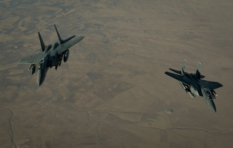 Two U.S. Air Force F-15E Strike Eagles depart after receiving fuel from a 908th Expeditionary Air Refueling Squadron KC-10 Extender during a flight in support of Operation Inherent Resolve June 2, 2017. The F-15E Strike Eagle is a dual-role fighter designed to perform air-to-air and air-to-ground missions. An array of avionics and electronics systems gives the F-15E the capability to fight at low altitude, day or night, and in all weather. (U.S. Air Force photo by Staff Sgt. Michael Battles)