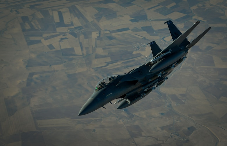 A U.S. Air Force F-15E Strike Eagle departs after receiving fuel from a 908th Expeditionary Air Refueling Squadron KC-10 Extender during a flight in support of Operation Inherent Resolve June 2, 2017. The F-15E Strike Eagle is a dual-role fighter designed to perform air-to-air and air-to-ground missions. An array of avionics and electronics systems gives the F-15E the capability to fight at low altitude, day or night, and in all weather. (U.S. Air Force photo by Staff Sgt. Michael Battles)