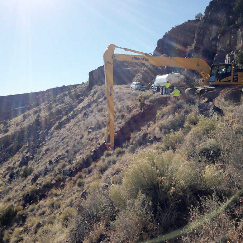 JEMEZ DAM, N.M. – Due to concerns that moving equipment into the area downslope of the culvert might damage cultural resources, the BLM crew used long-reach equipment from above to repair the culvert, Mar. 1, 2017.