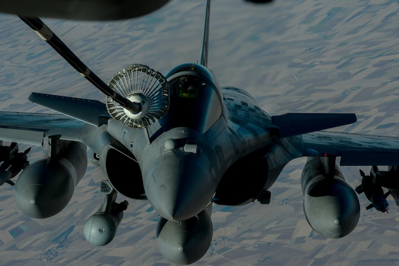 A French Naval Rafale receives fuel from a 908th Expeditionary Air Refueling Squadron KC-10 Extender during a flight in support of Operation Inherent Resolve June 2, 2017. Rafale is a French twin-engine, canard delta wing, multirole fighter aircraft with a wide range of weapons. The Rafale is intended to perform air supremacy, interdiction, aerial reconnaissance, ground support, in-depth strike and anti-ship strike missions. (U.S. Air Force photo by Staff Sgt. Michael Battles)