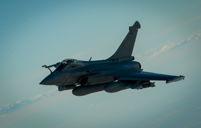 A French Naval Rafale departs after receiving fuel from a 908th Expeditionary Air Refueling Squadron KC-10 Extender during a flight in support of Operation Inherent Resolve June 2, 2017. Rafale is a French twin-engine, canard delta wing, multirole fighter aircraft with a wide range of weapons. The Rafale is intended to perform air supremacy, interdiction, aerial reconnaissance, ground support, in-depth strike and anti-ship strike missions. (U.S. Air Force photo by Staff Sgt. Michael Battles)