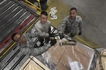 Airmen with the 305th Aerial Port Squadron prepare a pallet of cargo at Joint Base McGuire-Dix-Lakehurst, New Jersey, June 2, 2017. Mission essential cargo assembled by the Airmen is stored in the warehouse here prior to being shipped overseas.