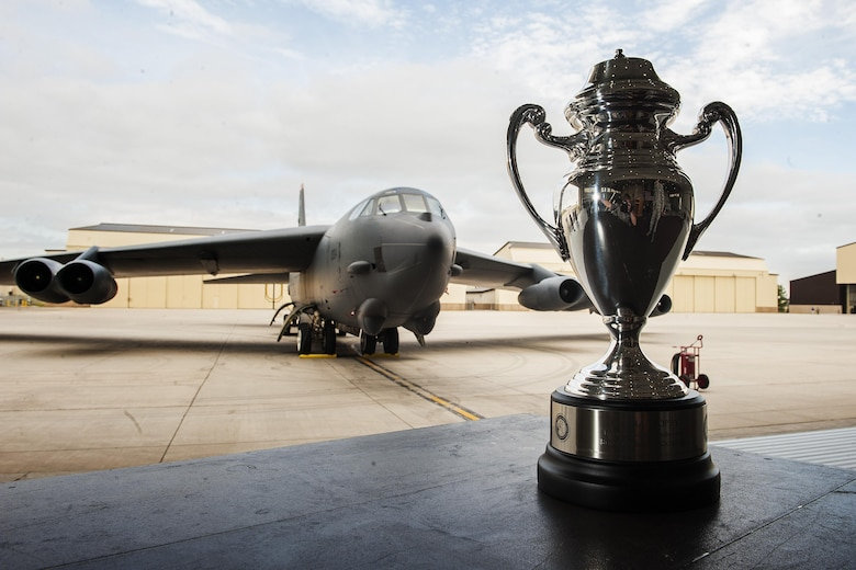 The Omaha Trophy stands in front of a B-52H Stratofortress at Minot Air Force Base, N.D., June 6, 2017. Gen. John E. Hyten, U.S. Strategic Command commander, presented the 5th Bomb Wing with the 2017 Omaha Trophy in the Strategic Bomber. (U.S. Air Force photo/Senior Airman J.T. Armstrong)