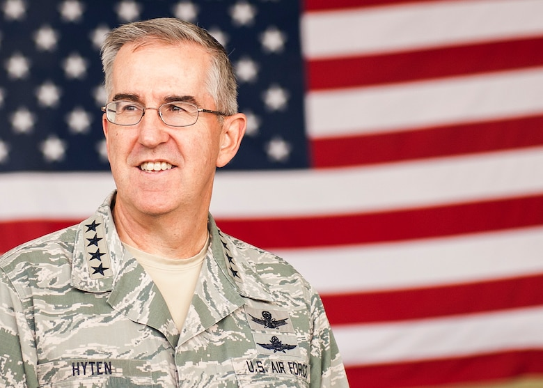 Gen. John E. Hyten, U.S. Strategic Command commander, stands in front of a flag at Minot Air Force Base, N.D., June 6, 2017. Hyten presented the 5th Bomb Wing with the 2017 Omaha Trophy in the Strategic Bomber category and recognized multiple Team Minot Airmen for their mission contributions. (U.S. Air Force photo/Senior Airman J.T. Armstrong)
