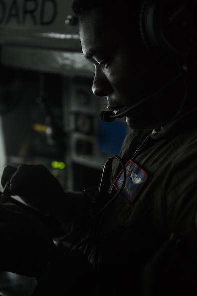 Senior Airman Thriston Noel, 351st Air Refueling Squadron boom operator, goes over the pre-flight check list for a
