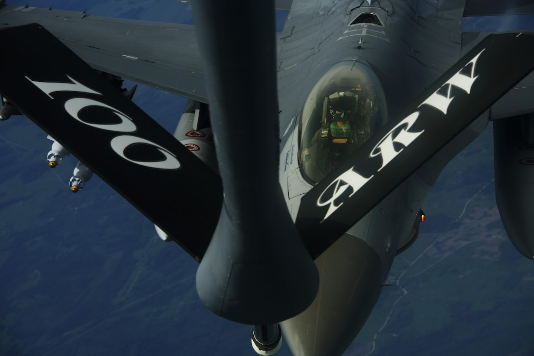 An F-16 Fighting Falcon, 510th Fighter Squadron, refuels from a KC-135R Stratotanker, 100th Air Refueling Wing, from RAF Mildenhall, England in support of Aviation Detachment rotation 17-3, exercise BALTOPS and exercise Saber Strike exercise over Latvia, June 7, 2017. BALTOPS is an annually recurring multinational exercise designed to enhance flexibility and interoperability, as well as demonstrate resolve of allied and partner forces to defend the Baltic region. Participating nations include Belgium,