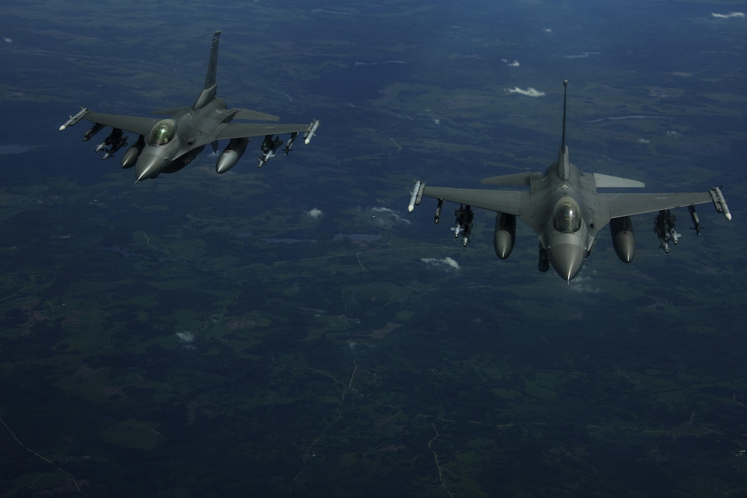 Two F-16 Fighting Falcons, 510th Fighter Squadron, are deployed to Krzesiny Air Base, Poland, in support of Aviation Detachment rotation 17-3, exercise BALTOPS and exercise Saber Strike fly over Latvia, June 7, 2017. BALTOPS is an annually recurring multinational exercise designed to enhance flexibility and interoperability, as well as demonstrate resolve of allied and partner forces to defend the Baltic region. Participating nations include Belgium, Denmark, Estonia, Finland, France, Germany, Latvia, Lithuania, the Netherlands, Norway, Poland, Sweden, the United Kingdom, and the United States. (U.S. Air Force photo by Staff Sgt. Jonathan Snyder)