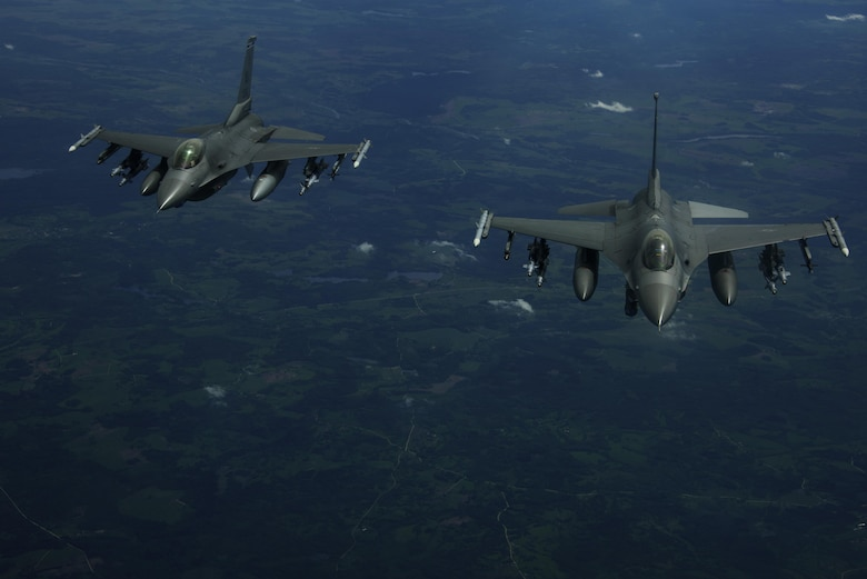 Two F-16 Fighting Falcons, 510th Fighter Squadron, are deployed to Krzesiny Air Base, Poland, in support of