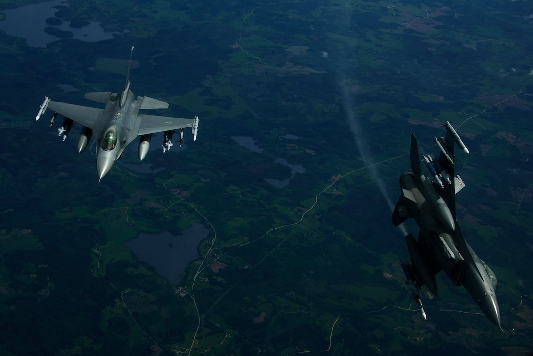 Two F-16 Fighting Falcons, 510th Fighter Squadron, are deployed to Krzesiny Air Base, Poland, in support of Aviation Detachment rotation 17-3, exercise BALTOPS and exercise Saber Strike fly over Latvia, June 7, 2017. The exercise, is designed to enhance flexibility and interoperability, to strengthen combined response capabilities, as well as demonstrate resolve among Allied and Partner Nations' forces to ensure stability in, and if necessary defend, the Baltic Sea region. (U.S. Air Force photo by Staff Sgt. Jonathan Snyder)