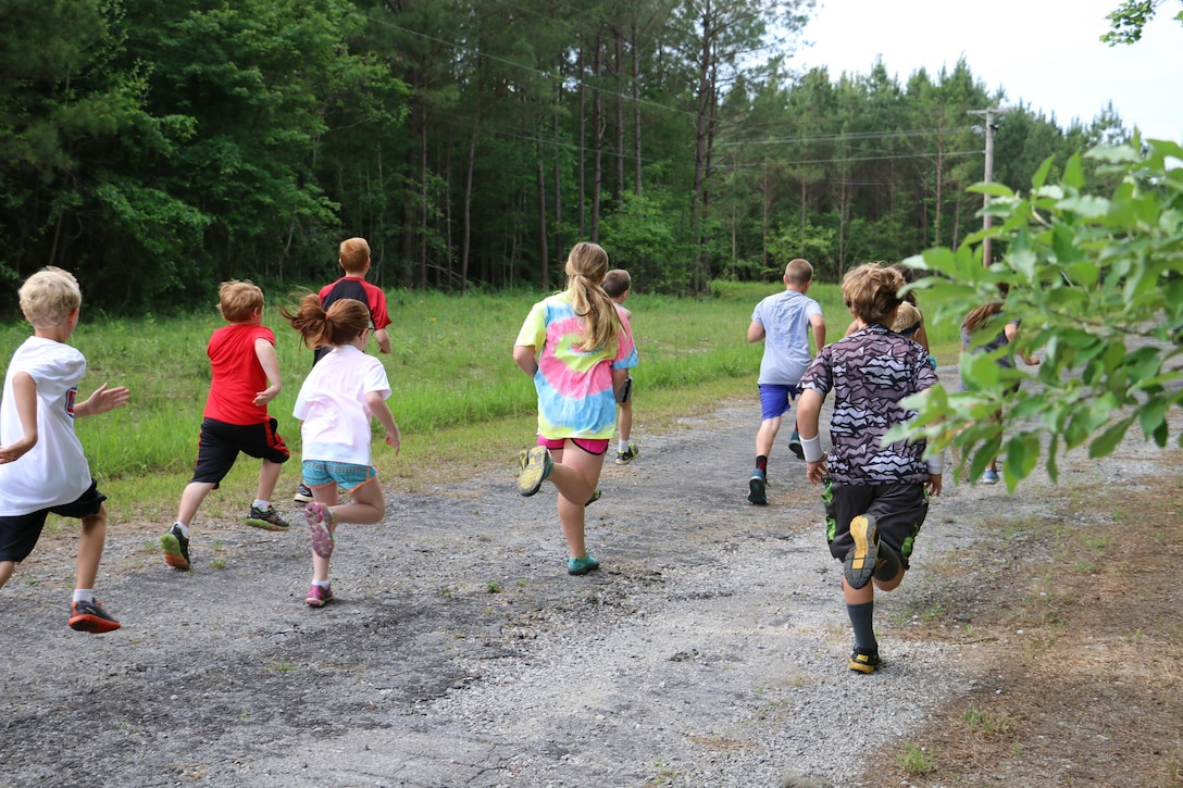 Local youth participate in the America's Kids Run, in which ages 5-13 ran a 1-mile course at their own pace. The America's Kids Run is part of Armed Forces Day activities worldwide at all branches of military bases giving children a noncompetitive outlet to express their love for the sport. In addition to the America's Kids Run, a 5K and 10K were held, open to people of all ages, and 10 award medals were presented by Col. Rodney Todaro, AEDC Commander, and Ron Stephenson, Services Fitness Center Manager. All runners also received a moisture wicking event t-shirt and a drawstring backpack with various promotional items for participating. (Photos provided)