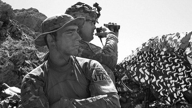 """Second  Lt. Andrew Dane stands watch while deployed as a Tactical Air Control Party specialist. In recounting his experience as a TACP specialist, Dane said """"I could still wear my beret and blouse my boots, I feel like (this) was fit for me."""" (Courtesy photo)"""