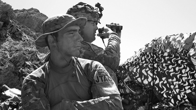 """U.S. Air Force 2nd Lt. Andrew Dane stands watch while deployed as a Tactical Air Control Party specialist. In recounting his experience as a TACP specialist, Dane said """"I could still wear my beret and blouse my boots, I feel like [this] was fit for me."""" (Courtesy photo)"""