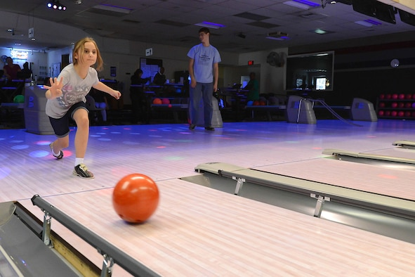 Ava Leinart bowls with her family during an event at Hanscom Lanes in 2015. This summer, children at Hanscom Air Force Base, Mass., and other Air Force installations have the opportunity to bowl for free, thanks to the Kids Bowl Free program. (U.S. Air Force photo by Jerry Saslav)