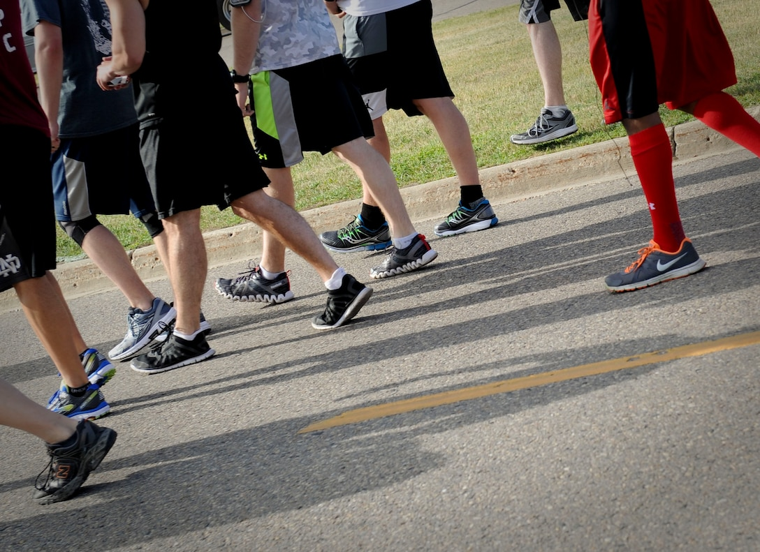 """Minot Air Force Base members teamed up with local law enforcement personnel to participate in the 2017 Law Enforcement Torch Run at Minot AFB, N.D., June 7, 2017. Every year more than 400 law enforcement personnel gather to promote the concept of partnership and prosperity as the """"Guardians of the Flame"""". This event was held in honor of the Special Olympics North Dakota State Summer Games and took place in communities across North Dakota including Bismarck, Grand Forks, Jamestown, Minot, Pembina and Valley City. (U.S. Air Force photo/Senior Airman Sahara L. Fales)"""