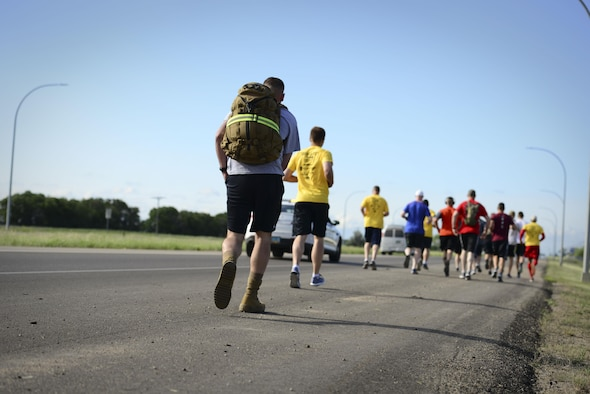 """Minot Air Force Base members teamed up with local law enforcement personnel to participate in the 2017 Law Enforcement Torch Run at Minot AFB, N.D., June 7, 2017. Every year more than 400 law enforcement personnel gather to promote the concept of partnership and prosperity as the """"Guardians of the Flame"""". This event was held in honor of the Special Olympics North Dakota State Summer Games and took place in communities across North Dakota including Bismarck, Grand Forks, Jamestown, Minot, Pembina and Valley City. (U.S. Air Force photo/Tech. Sgt. Evelyn Chavez)"""