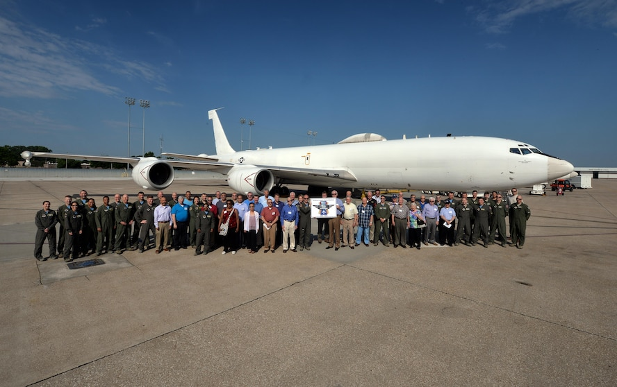 A group of past and present airborne missileers pose in front of an U.S. Navy E-6B Mercury to celebrate the 50th anniversary of the Airborne Launch Control System June 2. During their time here the group received a tour of the jet, a 625th Strategic Operations Squadron mission briefing, ate lunch at the Patriot Club and posed for a photo in front of an EC-135 Looking Glass, which is on static display next to the Kenney Gate (U.S. Air Force photo by Josh Plueger).