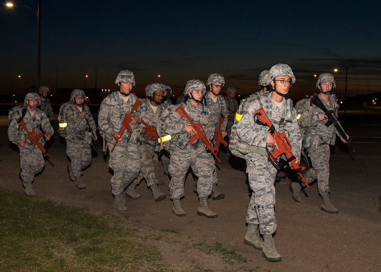 Airmen from the 5th Civil Engineer Squadron participate in a 10K ruck march at Minot Air Force Base, N.D., June 1, 2017. The 5th CES hosted an Expeditionary Training Day for Airmen to help develop and maintain skill sets required for potential deployment. (U.S. Air Force photo/Airman 1st Class Alyssa M. Akers)