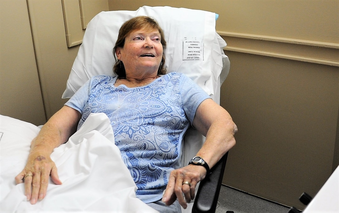 Carol Celeste Gray, a Nerve Scrambler Therapy patient, smiles as her nerve pain decreases as a result of the treatment she receives May 30, 2017 at Joint Base Andrews, Md. Recurring treatments over a certain amount of time have resulted in prolonged pain relief for Grey. (U.S. Air Force photo by Staff Sgt. Joe Yanik)