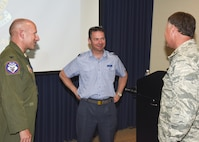 Flt. Lt. Andrew Wolfe, 607 Squadron (County of Durham) logistic officer, talks with Brig. Gen. Russ Walz, South Dakota National Guard director of joint staff, and Col. Gregory Lair, 114th Fighter Wing vice-commander, during his visit as part of the Military Reserve Exchange Program. MREP is a reciprocal exchange program which provides Guard and Reserve members, both officer and enlisted, the opportunity to train with select foreign allied nations and gain a better understanding how foreign powers operate. (U.S. Air National Guard photo by Tech. Sgt. Luke Olson/Released)