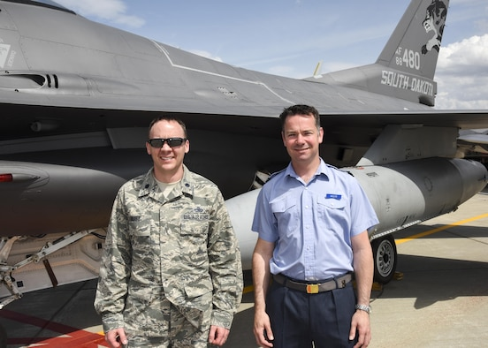 Flt. Lt. Andrew Wolfe, 607 Squadron (County of Durham) logistic officer, poses for a picture with Lt. Col. Scott Rust, 114th Fighter Wing plans officer, during his visit as part of the Military Reserve Exchange Program. Both Wolfe and Rust agreed building these relationships could benefit our allied forces down the road, so when they work with allied militaries they could use these relationships and experiences to enhance future relationships. (U.S. Air National Guard photo by Tech. Sgt. Luke Olson/Released)