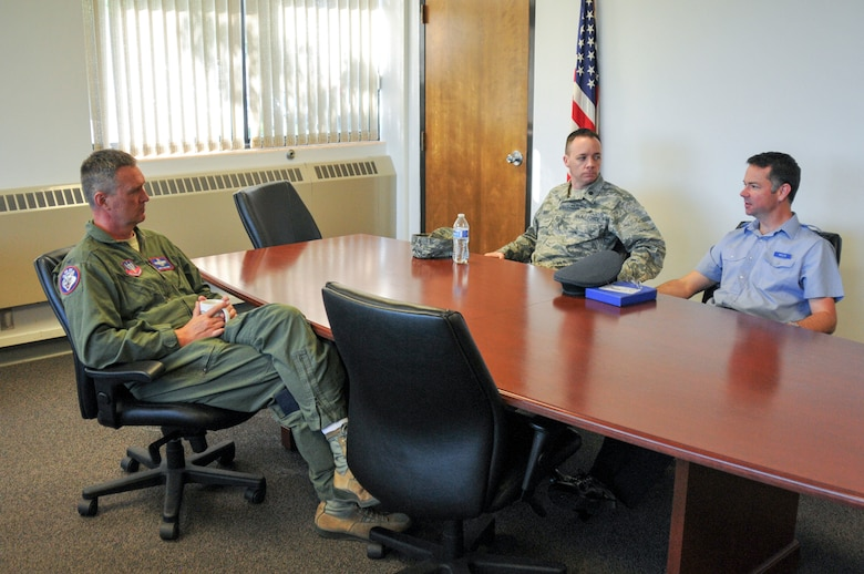 Royal Air Force Reservist Flt. Lt. Andy Wolfe, 607 Squadron (County of Durham), logistics officer, discusses differences and similarities between the U.S. and U.K. Reserve units with Col. Nathan Alholinna, 114th Fighter Wing commander, and Lt. Col. Scott Rust, 114th fighter Wing plans officer during his visit. Wolfe's visit is part of the Military Reserve Exchange Program. MREP is a reciprocal exchange program which provides Guard and Reserve members, both officer and enlisted, the opportunity to train with select foreign allied nations and gain a better understanding how foreign powers operate. (U.S. Air National Guard photo by Staff Sgt. Duane Duimstra/Released)