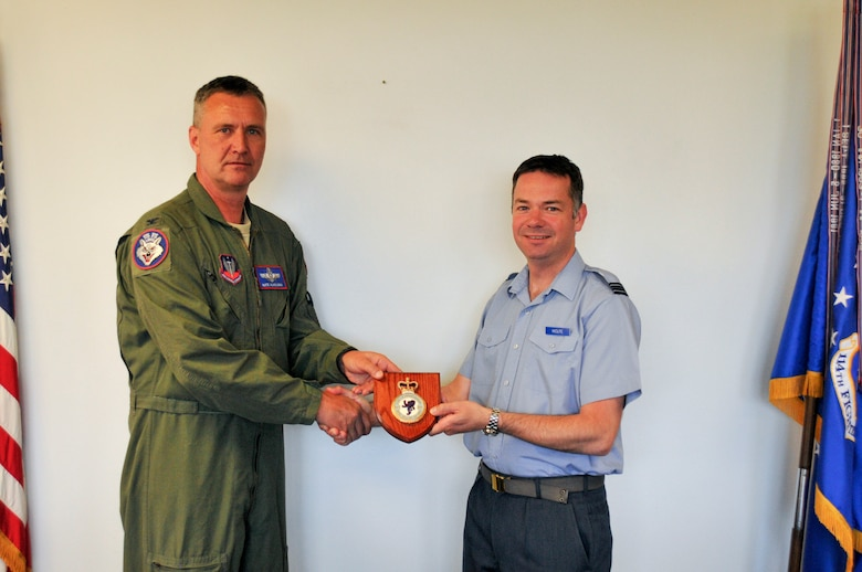 Royal Air Force Reservist Flt. Lt. Andy Wolfe, 607 Squadron (County of Durham), logistics officer, presents Col. Nathan Alholinna, 114th Fighter Wing commander, with an RAF Reserve 607 Squadron insignia plaque during his visit. Wolfe's visit is part of the Military Reserve Exchange Program. MREP is a reciprocal exchange program which provides Guard and Reserve members, both officer and enlisted, the opportunity to train with select foreign allied nations and gain a better understanding how foreign powers operate. (U.S. Air National Guard photo by Staff Sgt. Duane Duimstra/Released)