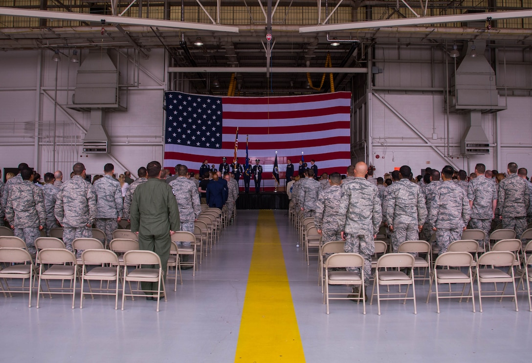 Airmen of the 489th Bomb Group stand at attention during the presentation of the colors at Dyess Air Force Base, Texas, June 3, 2017. Col. Michael McClanahan assumed command from Col. Denis Heinz during the ceremony. (U.S. Air Force photo by Staff Sgt. Jason McCasland/Released)