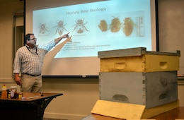 "Cory Koger, a senior chemist with U.S. Army Corps of Engineers Sacramento District, talks about various species of bees during a lunchtime ""brown bag"" event on April 20 in Sacramento. The Corps now takes into consideration endangered species of bees when working on cleanup and restoration projects in order to avoid harming the bees or their habitat."