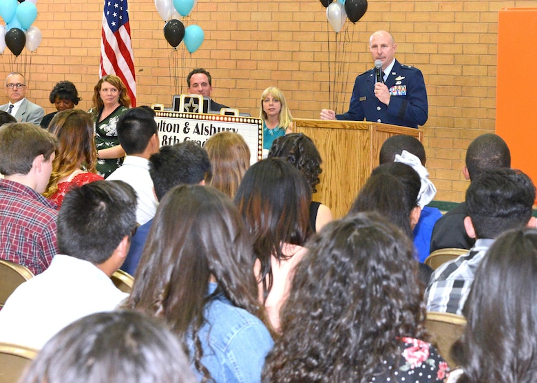 Brig. Gen. Carl Schaefer, 412th Test Wing commander, addresses eighth-graders at a promotion ceremony for Fulton and Alsbury Academy of Arts and Engineering students in Lancaster, California June 5. (U.S. Air Force photo by Kenji Thuloweit)