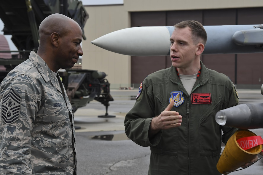 "Capt. Wayne Mowery 36th Fighter Squadron pilot, briefs Chief Master Sgt. of the Air Force Kaleth O. Wright on the F-16 Fighting Falcon's weapon systems by at Osan Air Base, Republic of Korea, June 7, 2017. The visit gave Wright the opportunity to interact with Airmen across the base, discuss concerns among the enlisted force and see the 51st Fighter Wing's ""Fight Tonight"" capabilities. (U.S. Air Force photo by Airman 1st Class Gwendalyn Smith/Released)"