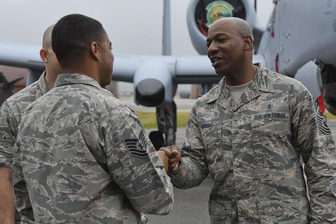 """Chief Master Sgt. of the Air Force Kaleth O. Wright visits Airmen at Osan Air Base, Republic of Korea, June 7, 2017. During his visit, he met with F-16 Fighting Falcon and A-10 Warthog crew members to discuss capabilities and sustainment to ensure air superiority to the """"Fight Tonight"""" mission. (U.S. Air Force photo by Airman 1st Class Gwendalyn Smith/Released)"""