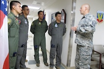 U.S. Air Force Master Sgt. Austin Blessard, Georgia Air National Guard 117th Air Control Squadron weapons and tactics non-commissioned officer in charge, introduces himself to members of the Colombian Air Force during a State Partnership Program Subject Matter Expert Exchange on Ground Control Intercept with the Georgia Air National Guard, May 30-June 2, 2017, at Hunter Army Airfield in Savannah, Georgia. During the weeklong engagement the Colombians worked with Air Controllers from 117th shaping Colombian Air Force training plans by pairing experts together to exchange ideas. The Georgia Air National Guard supported the South Carolina National Guard's State Partnership Program during the engagement.  (U.S. Air National Guard photo by Capt. Stephen D. Hudson)