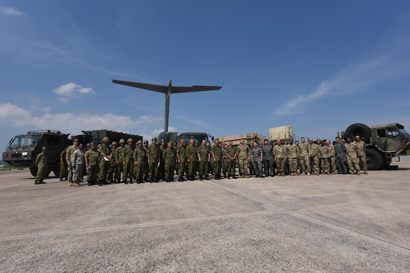 Japan Ground Self-defense Force, 1-1 Air Defense Artillery battalion and 18th Wing members pose for a group photo at the end of a two-day chemical, biological, radiological and nuclear defense exercise May 18, 2017, at Kadena Air Base, Japan. The operation was spent learning ways to improve operations and supplying guidance to help improve processes of the other units. (U.S. Air Force photo by Senior Airman Nick Emerick)