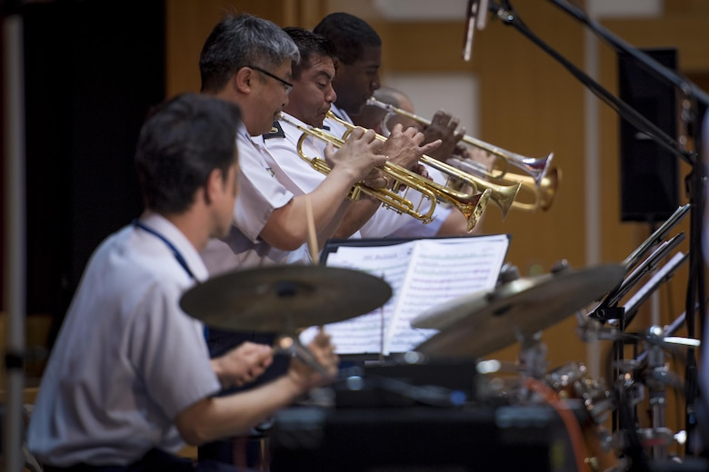 """The Joint Big Band plays the song, """"Hay Burner,"""" during a concert, June 7, 2017, at the Japanese Ministry of Defense, Tokyo, Japan. The Joint Big Band is scheduled to perform at local high schools in Tokyo to show how music can cross cultural barriers and demonstrate the cooperation and friendship between Japan and U.S. forces. (U.S. Air Force photo by Airman 1st Class Donald Hudson)"""